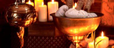 Luxury ayurvedic spa massage still life with burning candles.