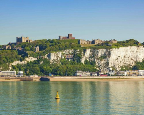 White cliffs of Dover, castle and beach in the morning
